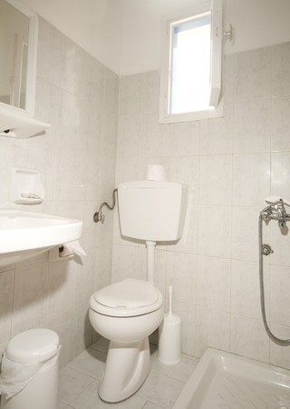 Stock Photo   Typical Compact All In One Bathroom With No Shower Curtain  And Garbage Bin For Toilet Paper Ios Island Cyclades Guest House In The  Greek ...