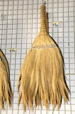 handmade straw sweeping dust broom brush photographed in cyprus
