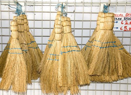 handmade straw sweeping dust brooms brushes photographed in cyprus