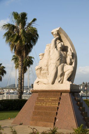 of homage: harbor waterfront statue monument homage to the resistance ajaccio corsica france Stock Photo