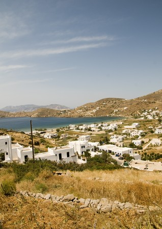 typical:  panoramic view of Cyclades Greek island of Ios with Mediterranean Aegean sea and mountains typical whitewashed buildings Greece