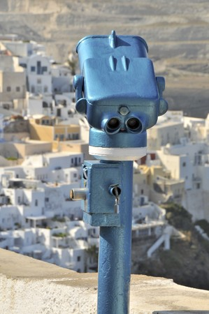 thira: old fashioned viewing panoramic rental binocular stand over thira santorini greek islands Stock Photo