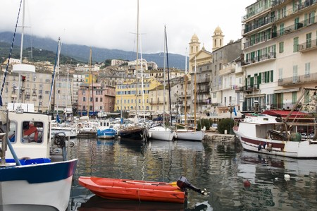 john the baptist: old port harbor Bastia, Corsica, France Mediterranean Sea with medieval architecture St. John the Baptist church Stock Photo