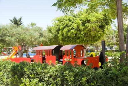 childrens tourism train in seaside municipal park garden Lemessos Limassol Cyprus