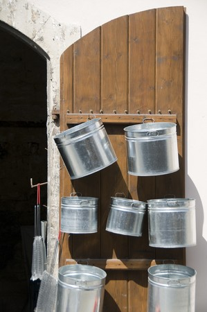 handmade steel pots display on medieval store door in divided capital of Lefkosia Nicosia Cyprus