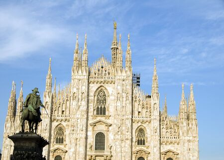 The Duomo Cathedral church Milan Italy with Madonna on spire tower detail with sculpture photo