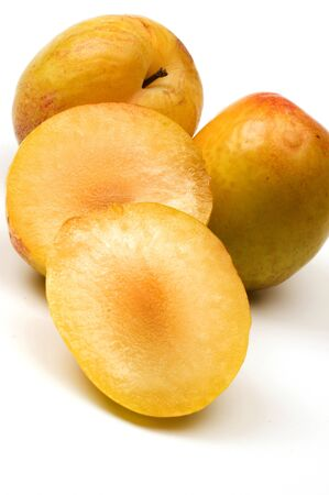 yellow green sweetie pluots hybrid fruit from plum and apricot horizontal Stok Fotoğraf