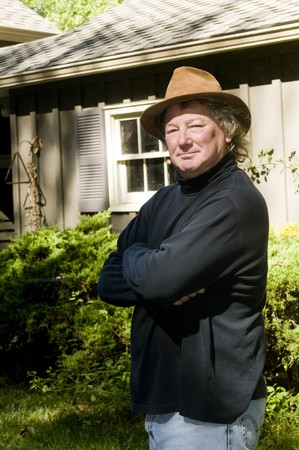 serious smile expression middle age handsome senior man with suede hat outdoors  photo