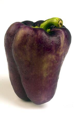 bell peper: purple bell chili peper on white background