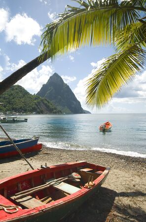 St. Lucia island view of famous twin piton mountain peaks from Soufriere beach native fishing boats in Caribbean Sea Фото со стока - 8419623