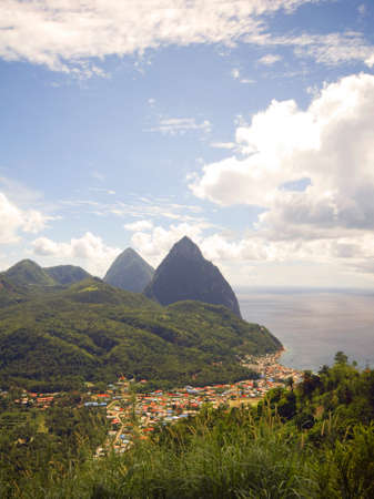 petit: panoramic view of famous twin Gros Petit Pitons mountains and Caribbean sea harbor Soufriere St. Lucia island