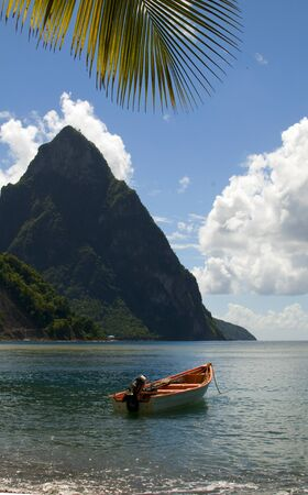 lucia:  St. Lucia island view of famous twin piton mountain peaks from Soufriere beach native fishing boats in Caribbean Sea