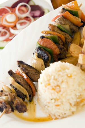beef chunk shish kabob on skewer with vegetables served with rice as photographed in Corn Island Nicaragua Central America