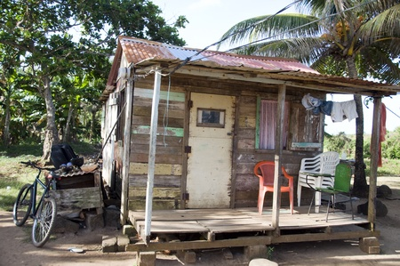shack: typical architecture old clapboard wood house with bicycle in tropical Big Corn Island Nicaragua Central America