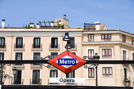 metro transit sign Opera stop at Madrid Opera House Royal Theater Spain typical historic architecture in background Archivio Fotografico