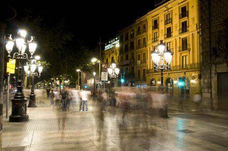barcelona spain: night scene motion blur La Rambla with tourists Barcelona Spain Europe
