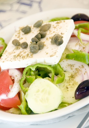 Greek salad with feta cheese Kalamata olives capers green peppers tomatoes onions as photographed in Ios Cyclades Island Greece photo