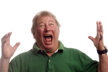 horrified:  middle age senior man emotional screaming in shock or fear   Stock Photo