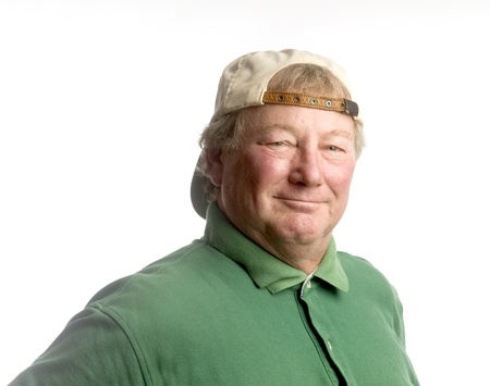 backwards: smiling handsome happy middle age senior man wearing casual hat backwards and green polo shirt