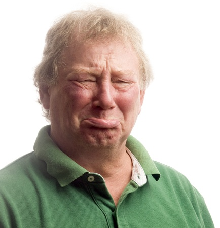 with humor: middle age senior man emotional funny face upset crying like a baby Stock Photo