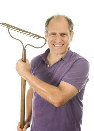 rake: handsome middle age senior man holding garden lawn bow rake tool