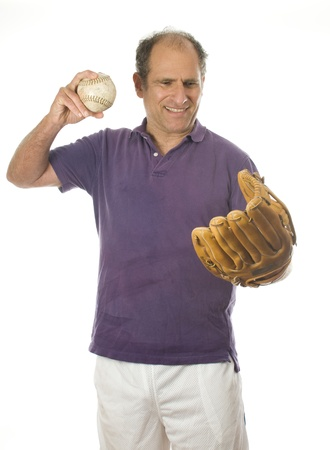 boomer: handsome middle age senior man softball throwing into baseball glove on white background