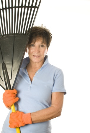 cute middle age senior female woman gardener smiling with leaf rake Stock Photo - 10618594