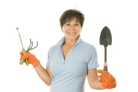 boomer: cute middle age senior female woman gardener smiling with gardening tools Stock Photo