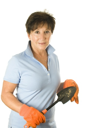 50 to 60: cute middle age senior female woman gardener smiling with hand tool trowel hoe spade Stock Photo