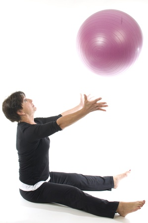 working out: middle age senior woman fitness exercise with core training ball Stock Photo