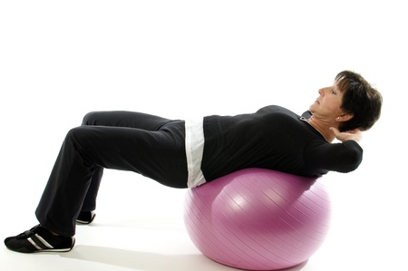 middle age woman: middle age senior woman fitness exercise  with core training ball for abdominal crunch sit-ups