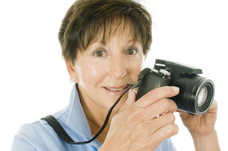 boomer: cute middle age senior female woman with compact digital camera Stock Photo