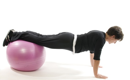 middle age women: middle age senior woman fitness exercise with core training ball push ups