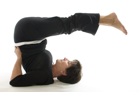 stretch out: middle age senior woman yoga stretch pose back stretch Stock Photo