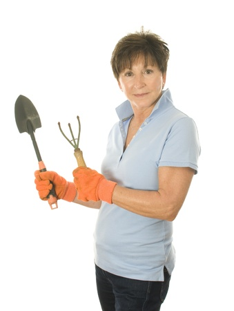 boomer: middle age senior woman gardener with hand gardening tools