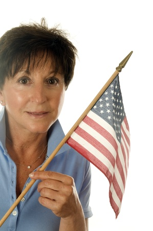 50 to 60: middle age senior woman American patriot with flag of USA Stock Photo