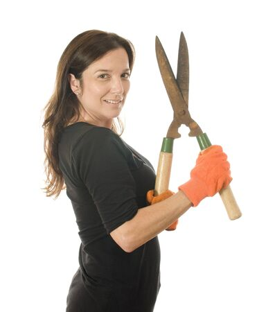 boomer: middle age  woman gardener with hand shears cutting tool Stock Photo