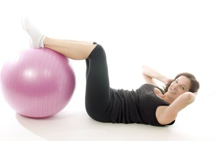 middle age women: woman female exercising with core training fitness ball sit up position