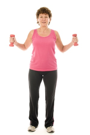 middle age senior woman fitness exercising arm bicep curls strength  training with dumbbell weights