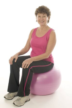 middle age woman: woman female exercising with core training fitness ball sit  Stock Photo