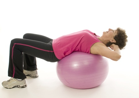 woman female exercising with core training fitness ball sit up position