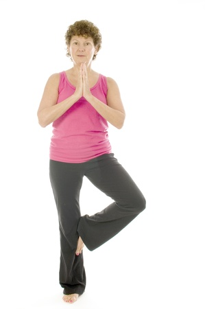 middle age senior woman fitness exercising yoga pose