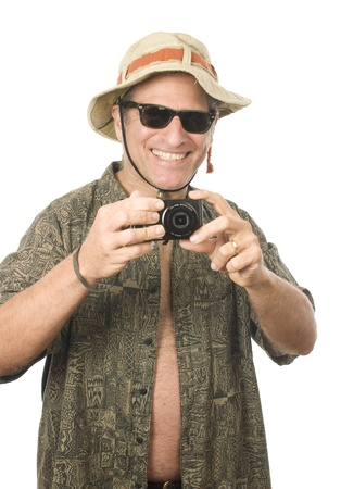 sun hat: middle age senior tourist male wearing funny sun hat sunglasses and taking photo with digital camera