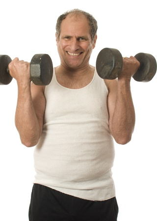 white work: middle age senior man working out exercising with dumbbell weights Stock Photo