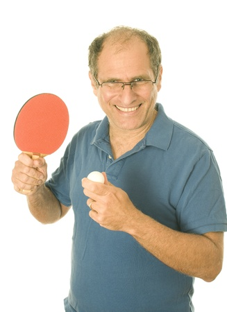 55 to 60: middle age senior man playing table tennis ping-pong with paddle and ball