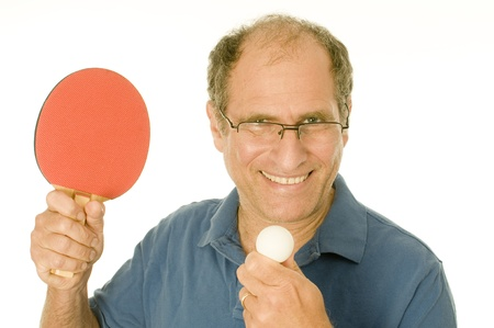 middle age senior man playing table tennis ping-pong with paddle and ball photo