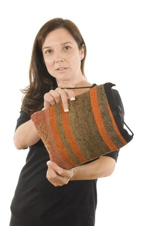 turkish woman: woman Turkish remnant kilim used for small shoulder satchel hand-bag pocketbook made in Turkey Stock Photo