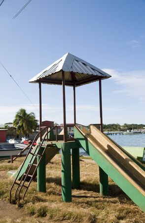 corn island: old fashioned slide ride childrens park waterfront Brig Bay Corn Island Nicaragua
