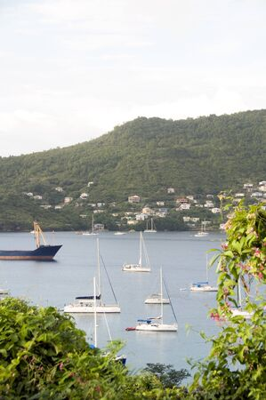 grenadines: Port Elizabeth harbor with yachts sail boats tankers with view of Hamilton residences Bequia St. Vincent and The Grenadines in Caribbean Sea