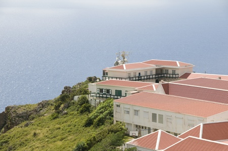village typical house business school architecture on cliff over Caribbean Sea on